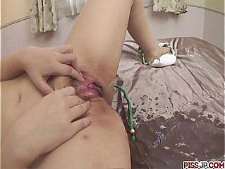 Minako Uchida getting naked and fondling her eager pussy with a vibrator