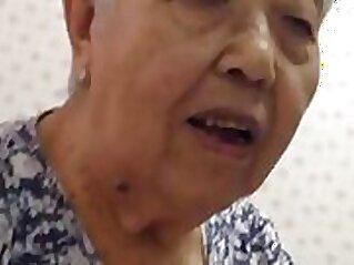 Beautiful dark haired Asian granny Kyler Blake enjoys eating sweet mess