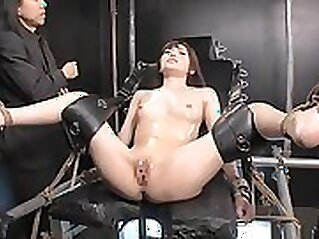 Crazy flexible Japanese babe chained to her max size till she screams with pain