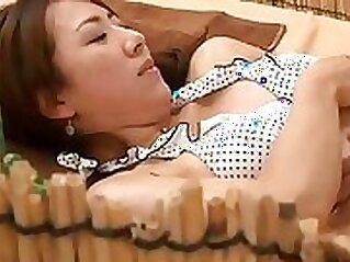 Attractive sporty brunette got a massage on the beach